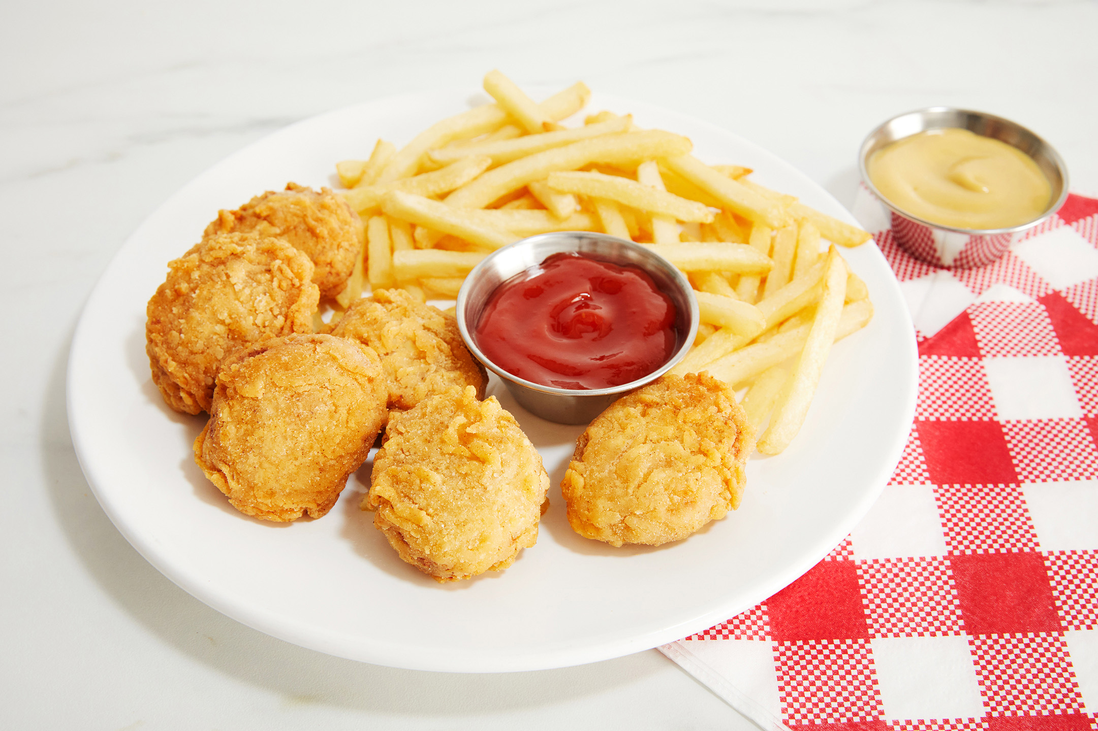 OZO brand Nuggets on a plate.